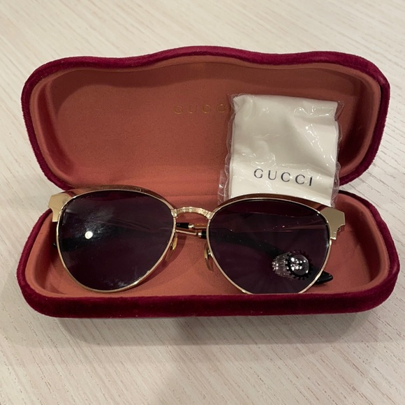 Gently used gold Gucci sunglasses